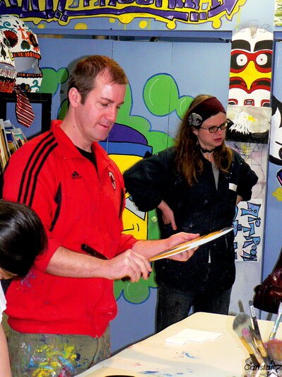Artists Jason Baerg and Karen Taylor take a look at some of the student art being constructed at the North End Arts Centre. By participating in the program youth have had the opportunity to work with professional artists.