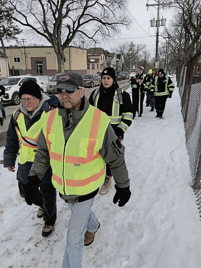 Chris Mott (left) and John King, Elmwood Bear Clan volunteers, were joined by Bear Clan members from the North End and West Broadway on a neighbourhood patrol on March 17. (SHELDON BIRNIE/CANSTAR/THE HERALD)