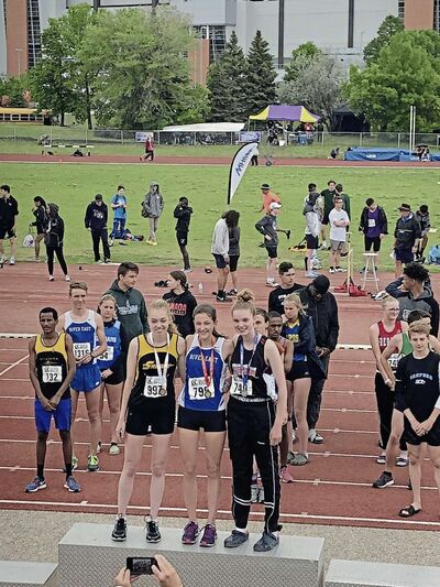 River East's Angela Kroeker (centre) won the girls varsity 3,000-metre race at the provincial high school track meet on June 8.