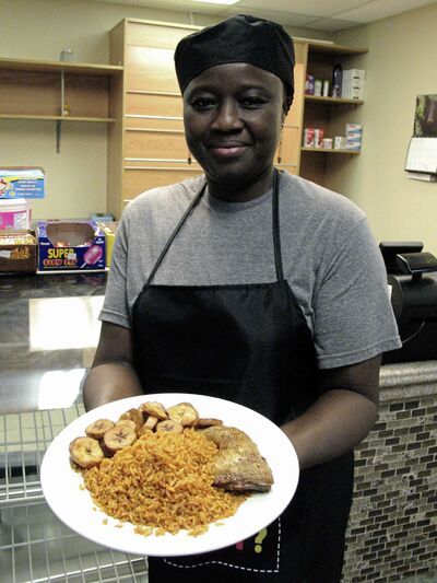 Folasade Akin-Akinbulumo with a plate of traditional West African fare she hopes to introduce to more Winnipeggers. (SIMON FULLERCANSTAR NEWS/THE LANCE)