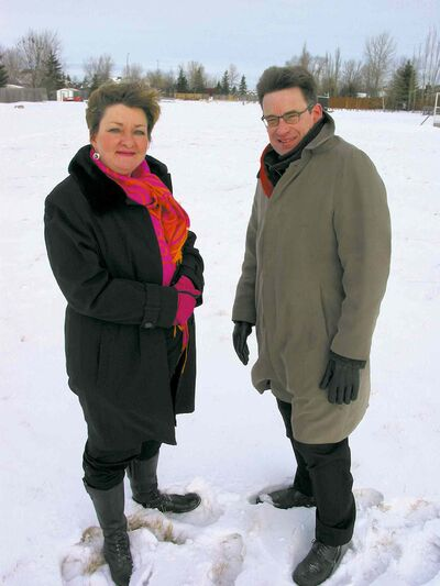 United they stand: Coun. Janice Lukes (St. Norbert) and Coun. Brian Mayes (St. Vital) stand by the boundary line of their wards on land south of Aldgate Road.