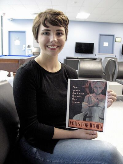 Kristen Braun, 21, holding a hard copy of her contest-winning poster.