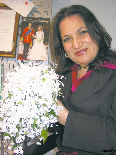 Designer Stella Mazza holds a replica of the bouquet she sent to the Duchess of Cambridge as a wedding gift.
