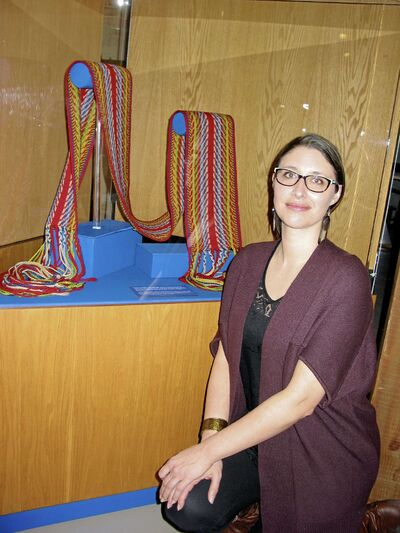 Vania Gagnon pictured with a sash that was worn by Louis Riel. The garment is in excellent condition and was returned to the province just in time for Manitoba's first Louis Riel Day in February 2008.
