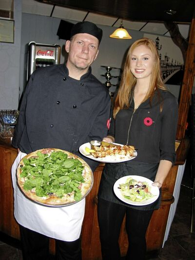 Chef Marc Deleau (left) and server Courtney Werner show off some of the dishes available at Helios Restaurant and Pizzeria, which opened its doors at 241 St. Mary's Rd. in St. Boniface last month.