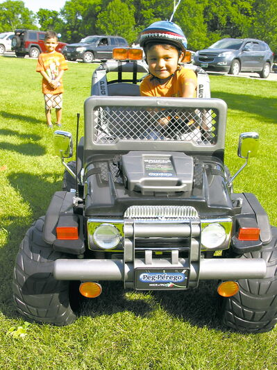 Isaiah, 3, drives his new jeep that was presented by The Dream Factory at St.Vital Park on July 19.