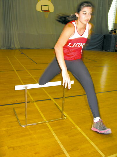 Chaudhary taking on the hurdles in the gym at Glenlawn Collegiate.