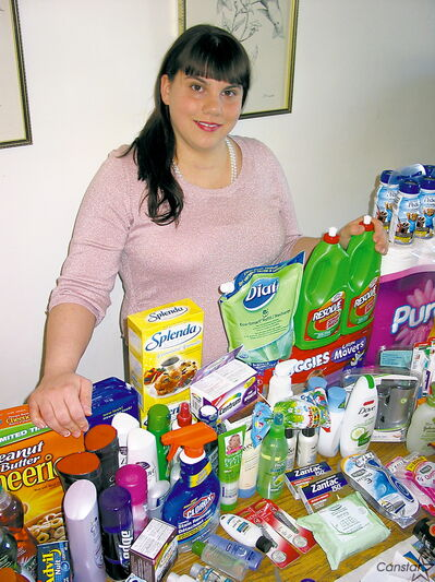 Michelle Roy with just some of the household items she picked up using coupons.