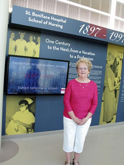 Shirley Delaquis, chair of the archives committee of the St. Boniface Registered Nurses' Alumni Association, by the new exhibit at St. Boniface Hospital.