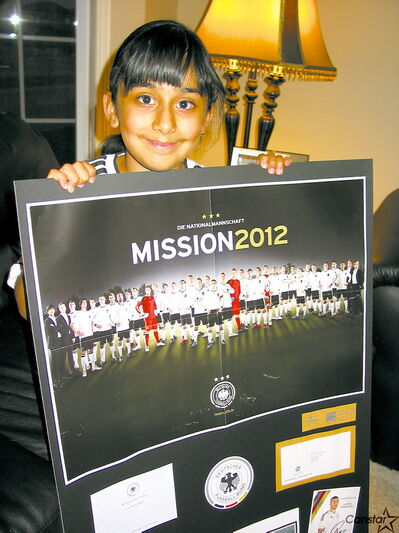 Esha Sandhu proudly displays some of her German soccer souvenirs.