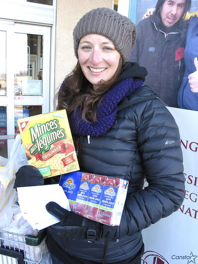 ICUC Moderation Services' Alisha Paul helps collect food items from shoppers outside Sobeys at Bishop Grandin Boulevard and St. Anne's Road for Siloam Mission in time for Easter.