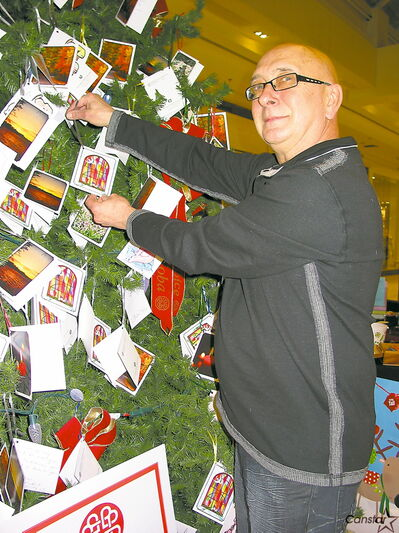Long-time volunteer Jim Krokosh by the Hospice Memory Tree in St. Vital Centre.