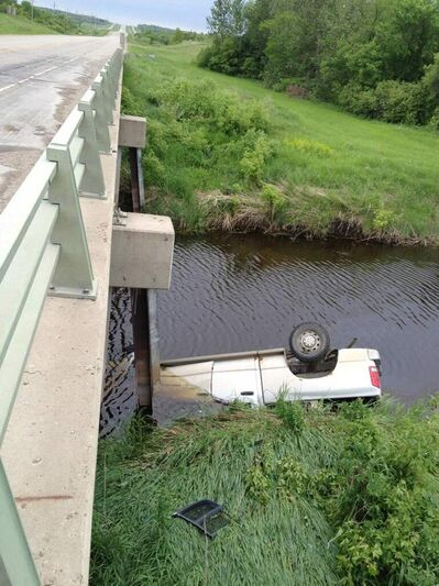 The partially submerged truck, approximately five kilometres south of Brandon on Highway No. 10. The driver got out safely, but was taken to hospital for minor injuries.  Hide caption A vehicle is partially submerged in a creek approximately five kilometres south of Brandon on Highway No. 10. Attempts are being made to remove the vehicle. Police are continuing to investigate. Unofficial reports say the driver got out safely.