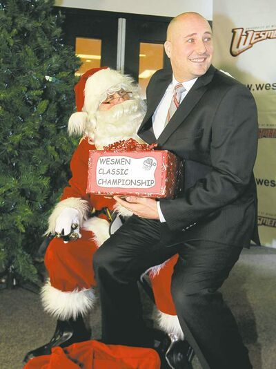 Boris minkevich / winnipeg free pressWesmen basketball coach Mike Raimbault wants a Classic championship from Santa. Opponents might have something to say about that, such as: Ho ho ho.