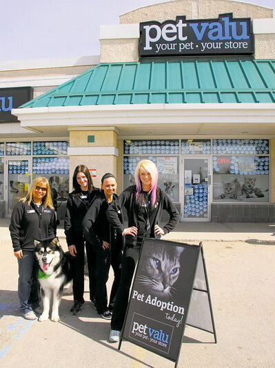 Gaylene Robertson, manager of Rivergrove Pet Valu, is pictured here with some of her staff during National Adoption Weekend.