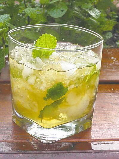Amy Stewart, author of The Drunken Botanist, recommends pressing 2 or 3 tablespoons of superfine sugar together with a small quantity of water to make a sugary paste. Add several sprigs of fresh spearmint, pressing them gently with a wooden spoon. Layer crushed ice, sugar and mint leaves and add a quantity of bourbon for a drink worthy of a long summer evening on your porch or deck.