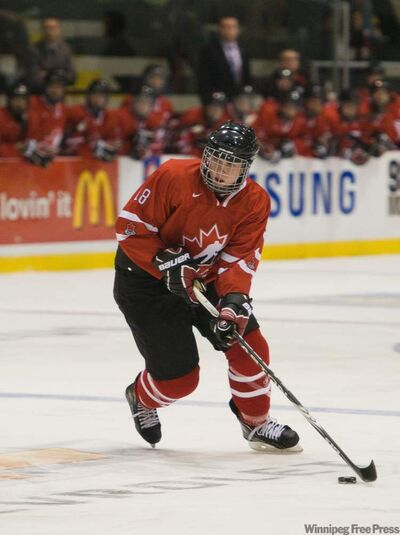 Team Ontario's Kerby Rychel prepares to fire a shot on the Slovakia net at the MTS Iceplex Thursday night.