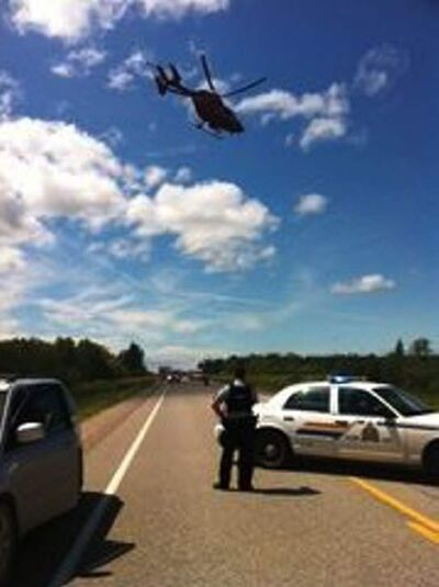 The STARS helicopter airlifts a victim from Saturday's fatal accident on Highway 317.