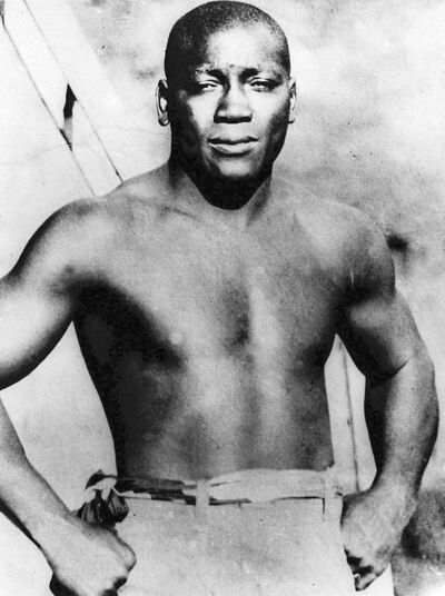 FILE - This undated file shows boxer Jack Johnson, who was born in Galveston, Texas. Johnson became the first African American to win the world champion heavyweight boxing title. He had approximately 113 bouts, only six losses and was inducted into the Boxing Hall of Fame in 1954. Lawmakers are going another round in their fight to get a posthumous presidential pardon for Johnson, who was imprisoned nearly a century ago because of his romantic ties with a white woman.  (AP Photo/File)