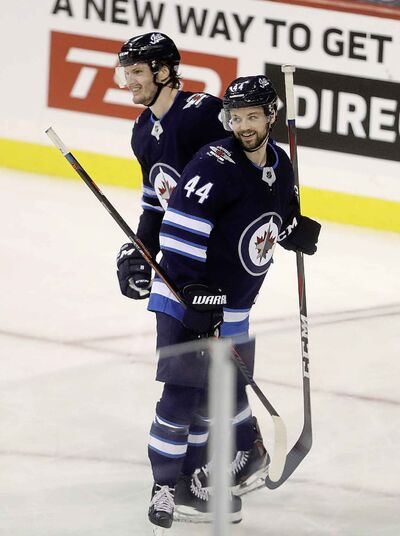Jacob Trouba (left) and Josh Morrissey may benefit the most from the increased ice time due to Byfuglien's injury.