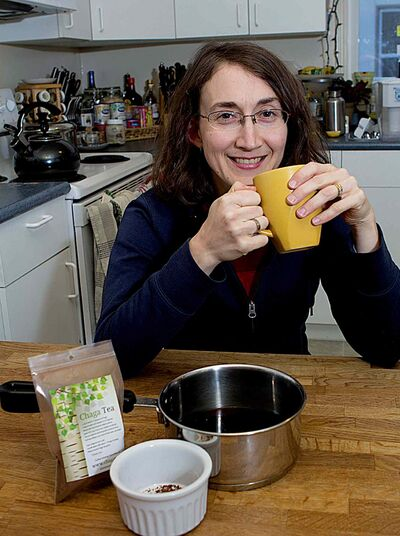 Sonya Braun enjoying a cup of chaga tea.