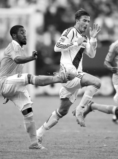 gina ferazzi / los angeles timesDavid Beckham (right), seen battling with Houston�s Corey Ashe, ended his run with MLS and the L.A. Galaxy Saturday.