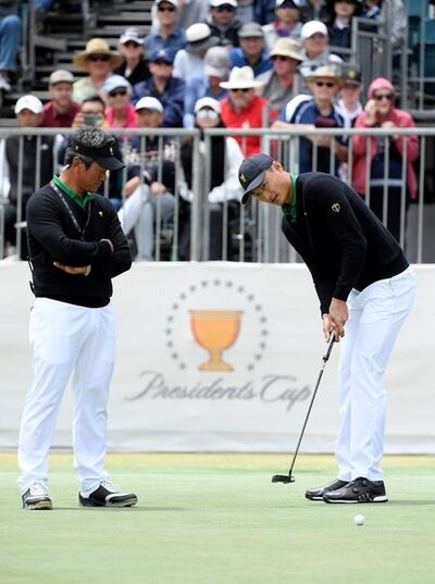 International Assistant captain K.J. Choi, left of South Korea and Haotong Li of China during a practice round ahead of the President's Cup Golf tournament in Melbourne, Wednesday, Dec. 11, 2019. (AP Photo/Andy Brownbill)