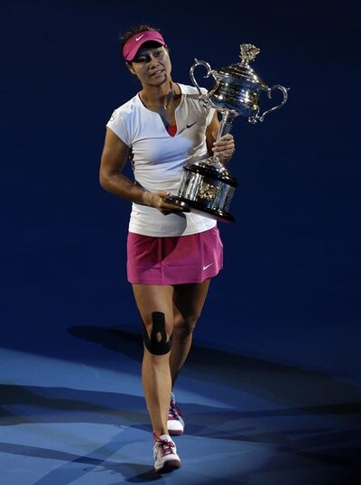 Li Na of China holds the championship trophy after defeating Dominika Cibulkova of Slovakiaduring their women's singles final at the Australian Open tennis championship in Melbourne, Australia, Saturday, Jan. 25, 2014.(AP Photo/Aijaz Rahi)