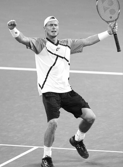 Lleyton Hewitt of Australia celebrates after an upset win over Roger Federer to claim the Brisbane International tennis tournament.