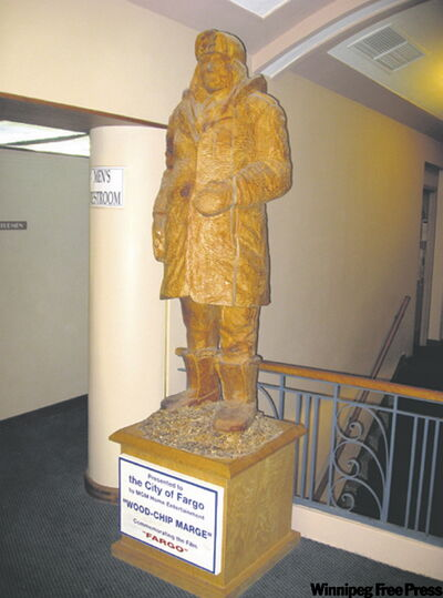 Wood-Chip Marge, a wooden statue of Police Chief Marge Gunderson, Frances McDormand's character in the movie Fargo, stands in the Fargo Theatre.