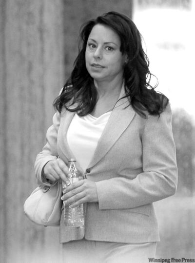 Kimberly Bell leaves a federal courthouse after she testified Monday in the perjury trial of Barry Bonds
