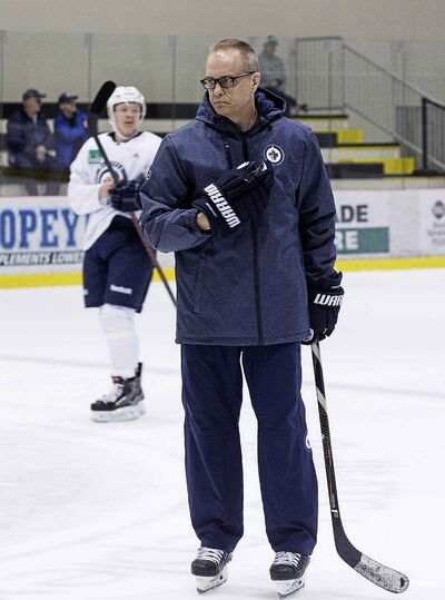Winnipeg Jets head coach Paul Maurice keeps an eye on team practice.