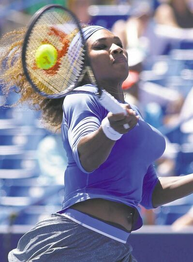 Al Behrman / the associated pressSerena Williams returns against Canadian Eugenie Bouchard during their match at the Western & Southern Open.