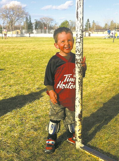 Four-year-old North Kildonan Community Centre soccer player James Lavallee revels in being outside.