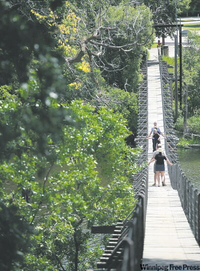 The longest swinging bridge in the world spans 582 feet over the Souris river.