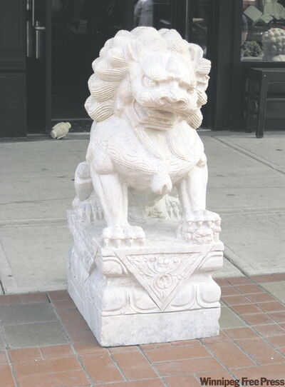 A statue of a Chinese dog stands on Broadway, fitting in perfectly with quirky downtown Fargo.