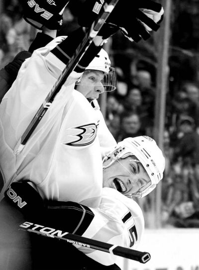 Anaheim Ducks right-winger Corey Perry (left) and teammate Ryan Getzlaf celebrate after teaming up for a Perry goal.