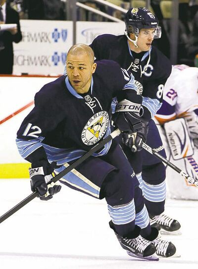 Pittsburgh Penguins' Jarome Iginla (12) and center Sidney Crosby warm up before an NHL hockey game against the New York Islanders in Pittsburgh, Saturday, March 30, 2013. The Penguins got the jump on everyone by dealing for Jarome Iginla, Brenden Morrow and Douglas Murray in the past two weeks. THE CANADIAN PRESS/AP/Gene J. Puskar