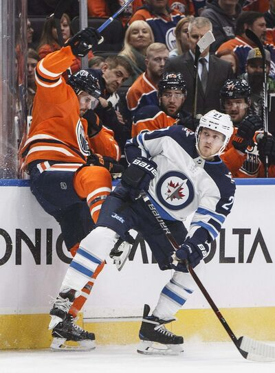 JASON FRANSON / THE CANADIAN PRESS</p><p>Winnipeg Jets&#39; Nikolaj Ehlers (27) checks Edmonton Oilers&#39; Kris Russell (4) during the first period Monday.</p>