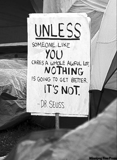 KEN GIGLIOTTI / WINNIPEG FREE PRESS A sign outside a tent in Memorial Park.
