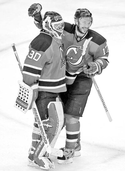 New Jersey Devils� Ilya Kovalchuk, right, of Russia, celebrates with goalie Martin Brodeur after beating the Philadelphia Flyers 4-2 in Game 4 of a second-round NHL hockey Stanley Cup playoff series, Sunday, May 6, 2012 in Newark, N.J. The Devils take a 3-1 lead in the series. (AP Photo/Julio Cortez)