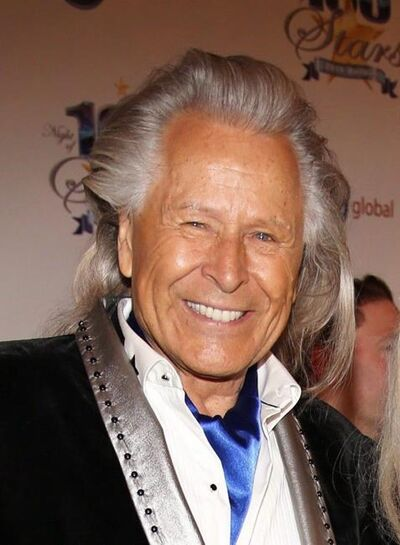 Following an FBI raid on his Manhattan headquarters over sex assault allegations, fashion mogul Peter Nygard says he is stepping down as chairman of his company. Peter Nygard, left, and Courtney Stodden arrive at the 24th Night of 100 Stars Oscars Viewing Gala at The Beverly Hills Hotel in Beverly Hills, Calif., on March 2, 2014. THE CANADIAN PRESS/AP, Invision - Annie I. Bang