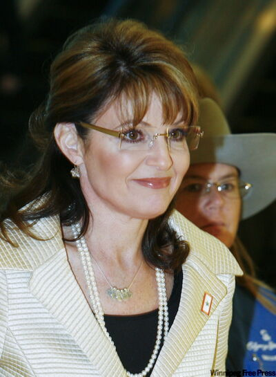 Sarah Palin, the former governor of Alaska and U.S. vice presidential candidate walks into her speaking engagement at the BMO Centre on Saturday.