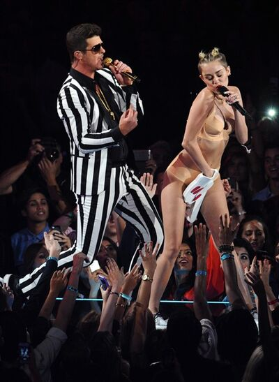 "Robin Thicke, left, and Miley Cyrus perform ""Blurred Lines"" at the MTV Video Music Awards on Sunday, Aug. 25, 2013, at the Barclays Center in the Brooklyn borough of New York. (Photo by Charles Sykes/Invision/AP)"