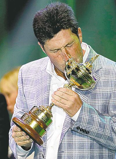 European team captain Jose Maria Olazabal kisses the trophy at the closing ceremony of the Ryder Cup PGA golf tournament Sunday, Sept. 30, 2012, at the Medinah Country Club in Medinah, Ill. (AP Photo/David J. Phillip)