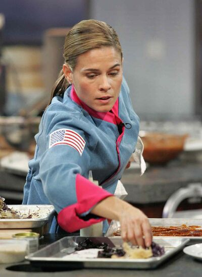 Cat Cora chose the culinary world after winning a cooking contest and meeting Julia Child. (Food Network)