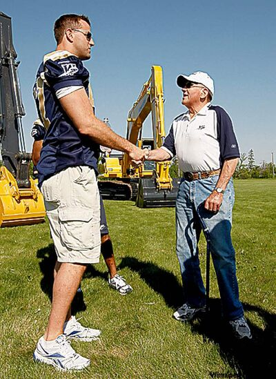 KEN  GIGLIOTTI / WINNIPEG FREE PRESS / MAY 20  2010 - 100520 - BRUCE OWEN STORY -   Blue Bomeber Doug Brown  talks to Ernie Karlowsky  grain farmer a 63 year ticket holder  before  ground breaking cerimony connection to  Izzy Asper - New Blue Bomber Stadium ground breaking took place at the UofM -the stadium will feature a world class 33,000 seat , to 40,000 for Grey Cup seating , 80% of fans will be weather protected , 40 private boxes - will be home to the Bombers and UofM Bisons - minor football palyers were invited  with CFL Com. Mark Cohon , Greg Selinger , David Asper , Sam Katz , UofM President David Barnard