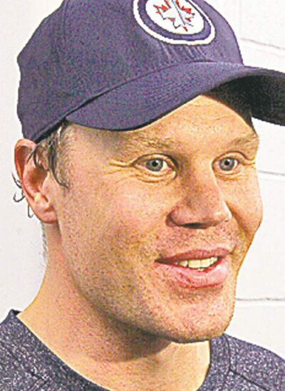 Winnipeg Jets player Olli Jokinen talks to media after skating with Jets and local pros at the MTS Iceplex Monday morning during lockout.