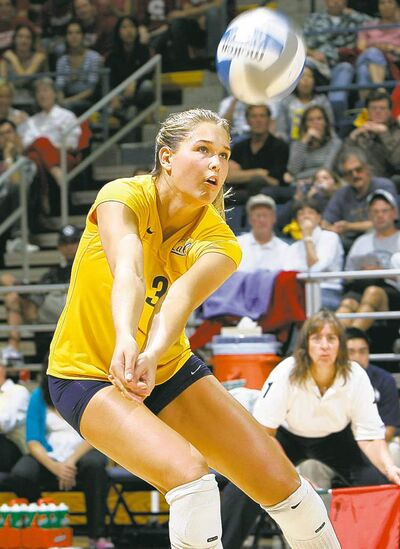In this photo taken Sept. 21, 2007, and provided by isiphotos.com, California volleyball player Morgan Beck hits the ball during a women�s NCAA college volleyball game in Berkley, Calif. Olympic and world champion skier Bode Miller has announced that he�s engaged to Beck. The five-time Olympic Alpine skiing medalist tweeted his engagement to the now professional volleyball player on Monday night, Sept. 17, 2012. (AP Photo/isiphotos.com, John Todd)