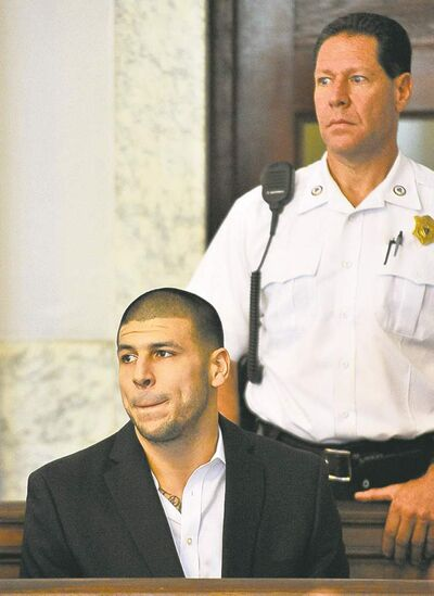Aaron Hernandez listens to court proceedings in Attleboro, Mass., Thursday.